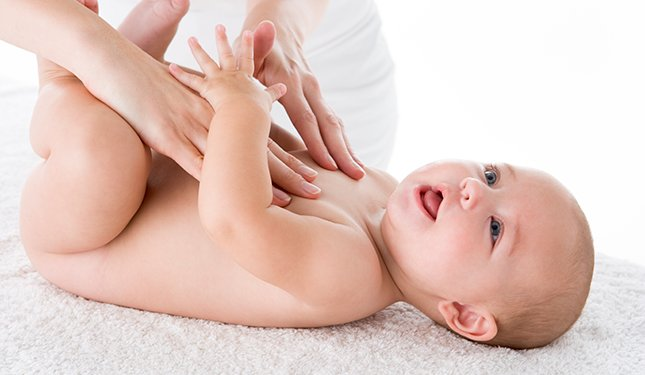 Baby Massage Instructor training course - Baby on back being massaged