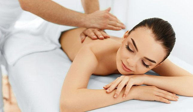 Body Massage Training Course image of client having a back massage
