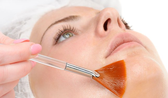 Chemical Skin Peels training course - applying a peel to a lady's face