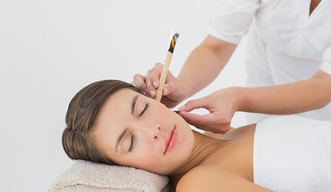 Ear Candling Training Courses - lady having treatment to left ear