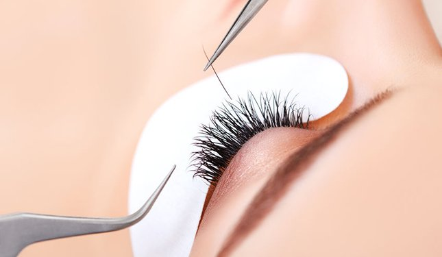 close up of semi-permanent eyelash extensions being applied