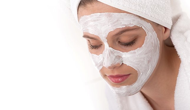 lady with face mask applied on NVQ Level 2 Beauty Course