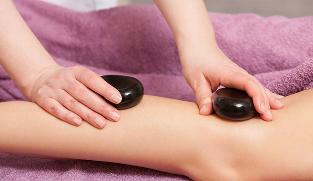 Hot Stone Massage Training Course - Image of back of legs being massaged