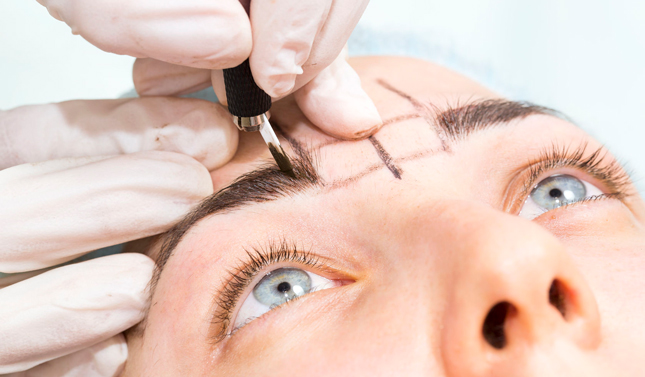 Microblading Training Courses - marking out area above right eye