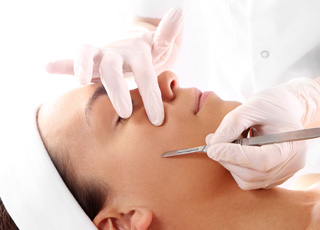image of student performing dermaplaning