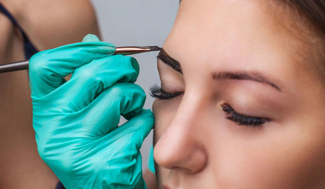 Image of woman having a henna brows treatment