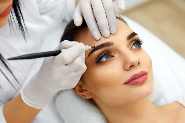 Microblading Training Courses - treatment application to left eyebrow
